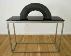 "Jeph Gurecka solo exhibition, ""Shiny Bright Souvenir"", 2008 31Grand Gallery, New York, NY. cast resin tire, metal, hardware, mounted on poured resin panel"