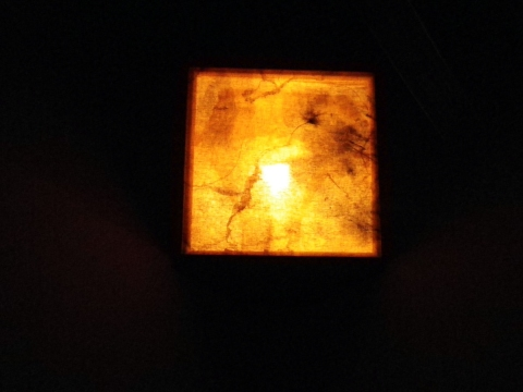  sculpture. rust on linen, incandescent bulb, duct tape