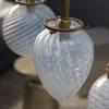 Michelle James NYC  <br/>MATERIALS:  brass, UL listed electrical components, 9 vintage opalescent glass globes<br/>