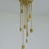 Michelle James NYC  <br/>MATERIALS:  brass, UL listed electrical components, 9 moveable brass arms<br/>