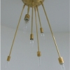 Michelle James NYC  <br/>MATERIALS:  brass, UL listed electrical components, 7 moveable brass arms<br/>