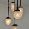 Michelle James NYC  <br/>MATERIALS:  5 repurposed vintage glass globes, brass, UL listed electrical components, vintage glass elements used as jewelry <br/>