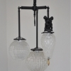 Michelle James NYC  <br/>MATERIALS:  brass, UL listed electrical components, 3 vintage glass globes, vintage brass elements<br/>