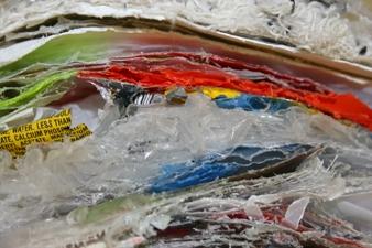 Sara Hubbs AS IS studio detritus from first semester of graduate school, (tape, paint, plastic, cloth, string, wax, etc.)