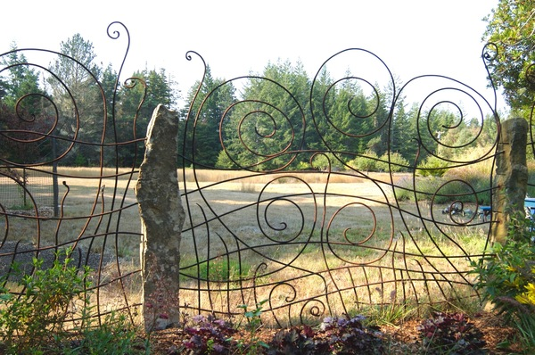 Rebecca Johnson Painter Sculptor commissions  forged  and welded steel,  limestone posts